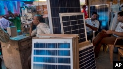 Solar panels are displayed for sale at a market in New Delhi, India, October 1, 2015.