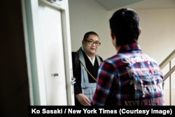 Junku Soto, a Buddhist priest, being greeted by a client. Credit Ko Sasaki for The New York Times