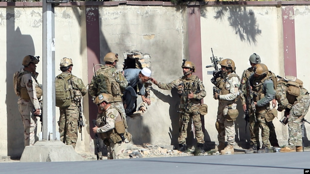 file afghan security personnel rescue a man from the shamshad tv compound after an attack