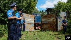 22일 말레이시아 여객기 희생자들의 시신을 실은 기차가 우크라이나 카르키브 시에 도착하고 있다.