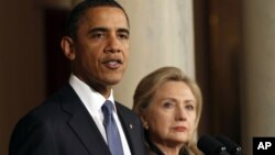 FILE - President Barack Obama with U.S. Secretary of State Hillary Clinton at the White House in 2011