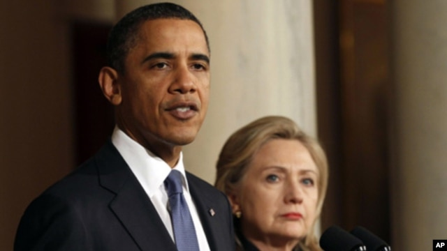U.S. President Barack Obama with U.S. Secretary of State Hillary Clinton (right) speaks about Libya at the White House,. February 23, 2011