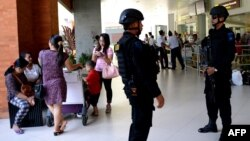 Indonesian Special Police patrol at Ngurah Rai Airport in Denpasar on Indonesia's resort island of Bali on Jan. 15, 2016, one day after a series of explosions hit the Indonesian capital Jakarta.