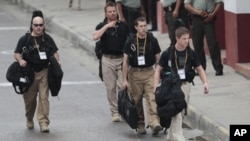 U.S. secret service agents walk around the Convention Center in Cartagena, Colombia, prior to the opening ceremony of the 6th Summit of the Americas, April 14, 2012.