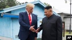 Donald Tramp və Kim Conq Un
