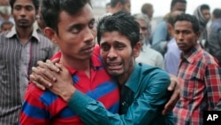 Bangladeshi people cry as rescuers search the Padma river after a passenger ferry capsized in Manikganj district, about 40 kilometers (25 miles) northwest of Dhaka, Bangladesh, Feb. 23, 2015.