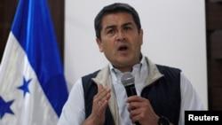 Honduras President and National Party candidate Juan Orlando Hernandez gestures as he addresses the media in Tegucigalpa, Honduras, Dec. 4, 2017.
