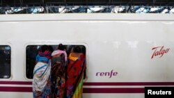 People look inside the parked high speed Talgo train during its trial run at a railway station in Mumbai, India August 2, 2016.