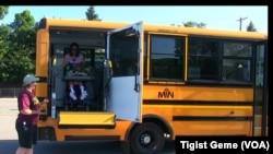 A Metropolitan Transportation Network bus picks up students for summer school in Minnesota, Aug. 8, 2017.