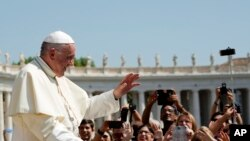 FILE - Pope Francis leaves after his weekly general audience, at the Vatican, Wednesday, Aug. 29, 2018. (AP Photo/Andrew Medichini)
