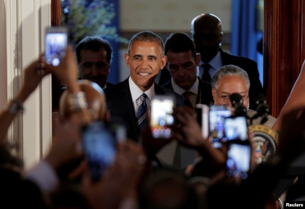 U.S. President Barack Obama arrives for a reception marking the opening of the Smithsonian's National Museum of African American History and Culture at the White House in Washington, Sept. 23, 2016.