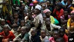 FILE - Refugees who fled Burundi's violence and political tension wait to board a U.N. ship, at Kagunga on Lake Tanganyika, Tanzania, to be taken to the port city of Kigoma, May 23, 2015.
