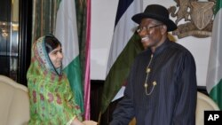 FILE - Malala Yousafzai shakes hands with Nigerian President, Goodluck Jonathan, in Abuja, July 14, 2014.