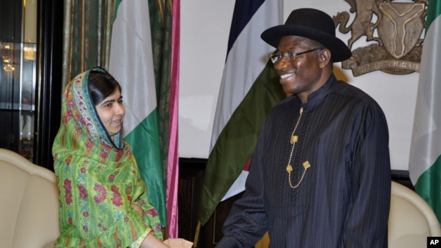 FILE - Malala Yousafzai shakes hands with Nigerian President, Goodluck Jonathan, in Abuja, July 14, 2014.