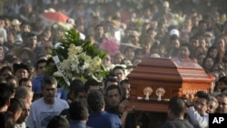 Mourners carry the coffin of slain mayor of Temixco, Gisela Mota, to the cemetery in Pueblo Viejo, Mexico, Sunday, Jan. 3, 2016. A new study suggests that Mexico's drug violence was so bad at its peak that it apparently caused the nation's male life expectancy to drop by several months.