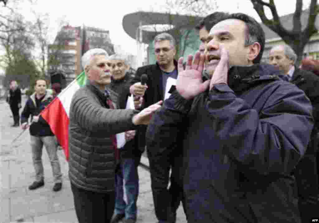 Demonstrators shout slogans towards the Iranian embassy, as they protest to show solidarity to the people of Iran and others fighting for freedom, in Brussels, Monday, Feb. 14, 2011. (AP Photo/Yves Logghe)