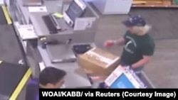 A surveillance image shows the serial bombing suspect inside a FedEx office store in Austin, Texas, which was given to law enforcement and obtained by TV station, WOAI/KABB, March 21, 2018.