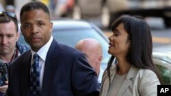 FILE - Former Illinois Rep. Jesse Jackson Jr. and his wife, Sandra, arrive at federal court in Washington.