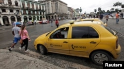 A taxi driver awaits customers in Havana, Cuba, Jan. 8, 2014.