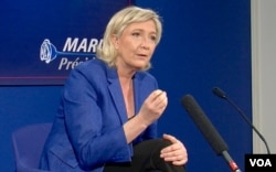 Marine Le Pen criticizes the European Union as being responsible for the Ukraine crisis with Russia. (L. Bryant/VOA)