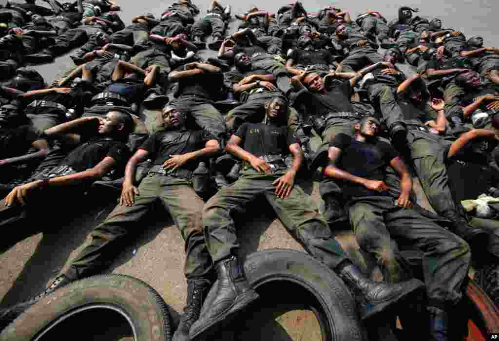 Thai police commandos take a rest during an anti-terrorist exercise at Crime Suppression Division in Bangkok, Thailand.