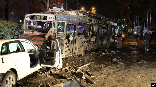 Damaged vehicles are seen at the scene of an explosion in Ankara, Turkey, March 13, 2016.