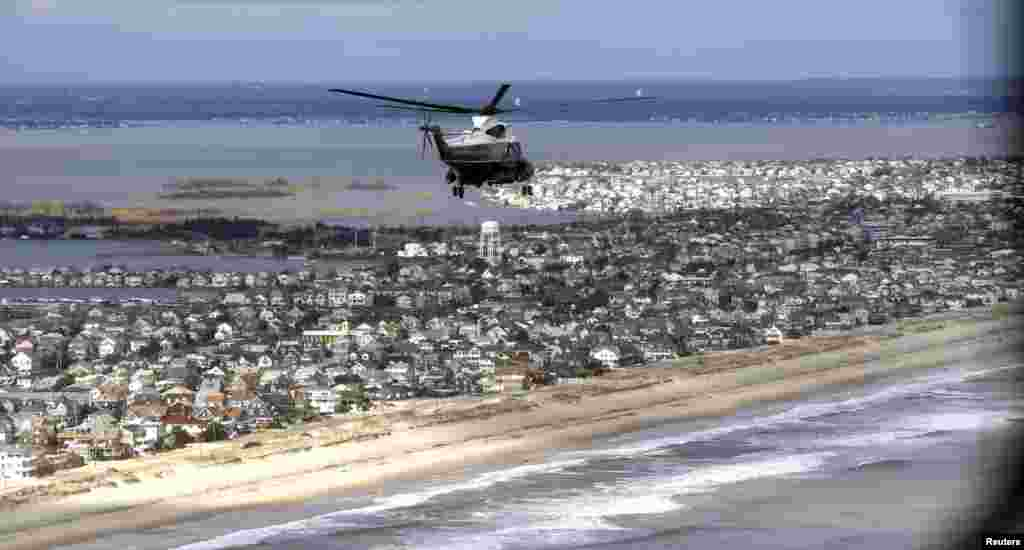 Marine One with President Barack Obama and New Jersey Governor Chris Christie on board view the storm damage around Atlantic City, New Jersey, October 31, 2012.