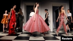 FILE - Models present creations during the Monse and Oscar de la Renta Autumn/Winter 2017 collection during New York Fashion Week in the Manhattan borough of New York, Feb. 13, 2017.