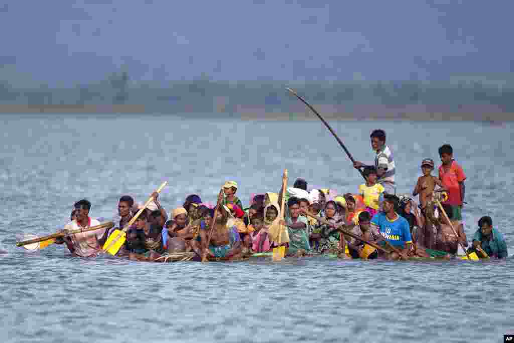 Rohingya Muslims cross over the Naf river on a raft made with plastic containers near Shah Porir Dwip, Bangladesh.