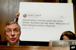 Sen. Dick Durbin, D-Ill., ranking Member of the Senate Committee on the Judiciary, Subcommittee on Border Security and Immigration, speaks while a staffer holds up a Twitter quote by President Donald Trump, during a subcommittee hearing about the border.