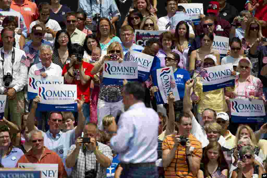 Supporters of Republican presidential candidate Mitt Romney watch him speak at a campaign stop in front of the Licking County Court House in Newark, Ohio, June 17, 2012