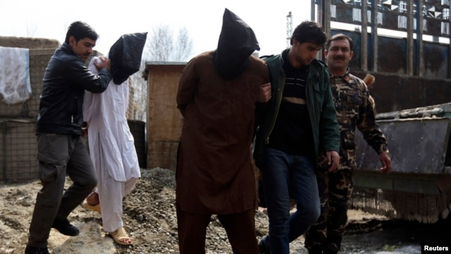 Suspected insurgent Taliban are presented to the media at the National Directorate of Security (NDS) headquarter in Kabul, March 15, 2013.