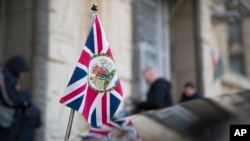 The British Union flag flies from the front of a car as British ambassador to Russia, Laurie Bristow attends a meeting at the Russian foreign ministry building in Moscow, Russia, March 17, 2018.