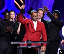 """FILE - Jordan Peele accepts the award for best feature for """"Get Out"""" at the 33rd Film Independent Spirit Awards in Santa Monica, Calif., March 3, 2018."""