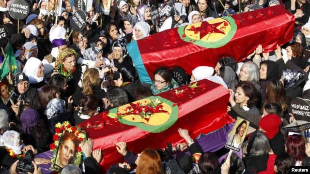 Funeral of three Kurdish activists shot in Paris, Diyarbakir, Turkey, Jan. 17, 2013.