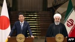 伊朗总统鲁哈尼6月12日在德黑兰与日本首相安倍晋三举行联合记者会。