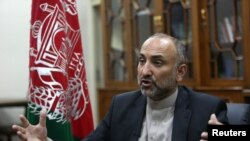 FILE - Afghan National Security Adviser Hanif Atmar speaks with The Associated Press, in Kabul, Afghanistan, Oct. 24, 2015.
