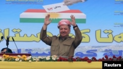 Iraqi Kurdish President Masoud Barzani gestures as he attends a rally in support for the Sept. 25 independence referendum in Zakho, Iraq, Sept. 14, 2017.
