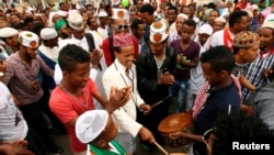 FILE - Muslim men sing after attending Eid al-Fitr prayers to mark the end of the holy fasting month of Ramadan in Addis Ababa, Ethiopia, July 6, 2016.
