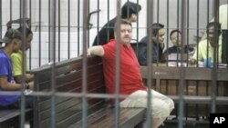 Suspected Russian arms dealer Viktor Bout sits in a holding cell on 8 March 2008, following an appearance at Criminal Court in Bangkok, Thailand.