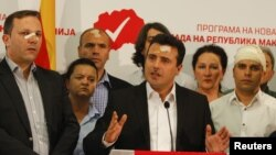 Macedonian Social Democratic leader Zoran Zaev, center, and members of his party attend a news conference in Skopje, Macedonia, April 28, 2017, a day after protesters attacked parliament.