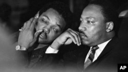 FILE - Dr. Martin Luther King, Jr. is seen here with Rev. Jesse Jackson (L) just prior to his final public appearance to address striking Memphis sanitation workers, April 4, 1968.