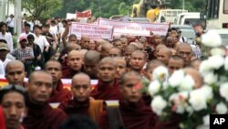 Burmese Buddhist monks march through streets in Rangoon, Burma, October 8, 2012.