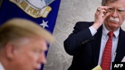 Bivši savetnik za nacionalnu bezbednost Džon Bolton i predsednik SAD Donald Tramp, (arhivski snimak)