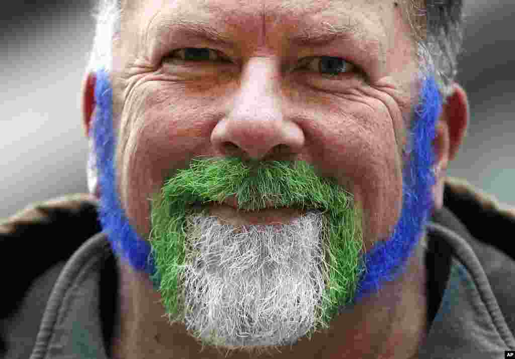 Ron Hebron, of Portland, Oregon, wears his beard with Seattle Seahawks colors on Super Bowl Boulevard in Times Square in New York, Jan. 31, 2014.