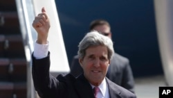 U.S. Secretary of State John Kerry flashes the thumbs-up sign as he arrives at Manila's International Airport, Philippines on Tuesday, Dec. 17, 2013.