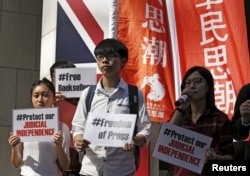 FILE - Members of student group Scholarism protest the disappearance of booksellers outside the British consulate in Hong Kong, Jan. 6, 2016.