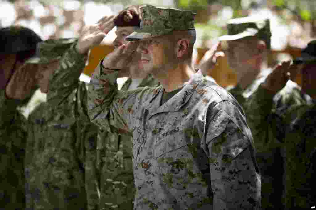 General John Allen, the top U.S. commander in Afghanistan, salutes before he observes Memorial Day at ISAF headquarters in Kabul, Afghanistan, May 28, 2012.