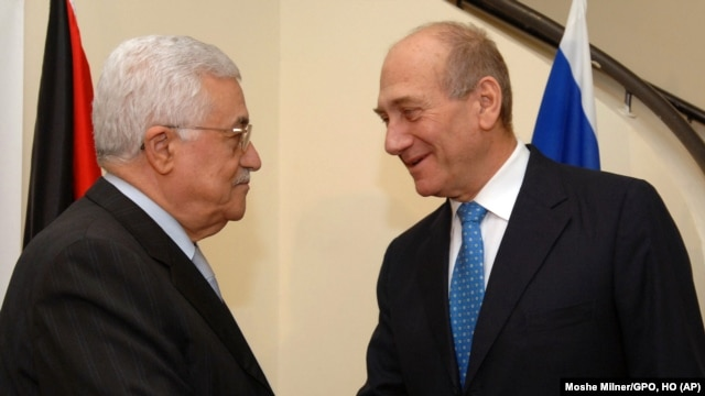 FILE - Israeli Prime Minister Ehud Olmert, right, shakes hands with Palestinian President Mahmoud Abbas, in the prime minister's residence in Jerusalem, Oct. 3, 2007.