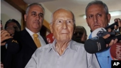 FILE - Kenan Evren, center, casts his ballot during a referendum in Ankara, Turkey, Sept. 12, 2010.